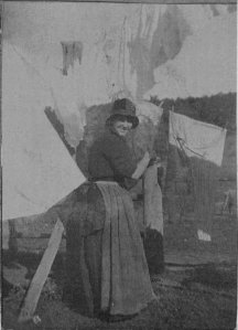 Mary Maude Wilson (Delaney) hanging out the washing at Moyne Farm