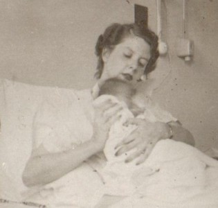 My mother, with me at one week old