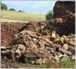 Part-demolished brick wall, via www.gwsr.com